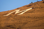 Hikers on the trail to the M on Mount Sentinel above Missoula, Montana