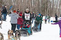 Damon Ramaker and team run past spectators on the bike/ski trail near University Lake with an Iditarider in the basket and a handler during the Anchorage, Alaska ceremonial start on Saturday, March 7 during the 2020 Iditarod race. Photo © 2020 by Ed Bennett/Bennett Images LLC