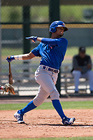 Chicago Cubs shortstop Josue Huma (13) follows through on his swing during an Extended Spring Training game against the Colorado Rockies at Sloan Park on April 17, 2018 in Mesa, Arizona. (Zachary Lucy/Four Seam Images)
