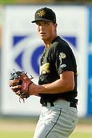 West Virginia Power starting pitcher Tyler Glasnow (24) warms up in the outfield prior to the game against the Kannapolis Intimidators at CMC-Northeast Stadium on July 9, 2013 in Kannapolis, North Carolina.  The Power defeated the Intimidators 3-1.   (Brian Westerholt/Four Seam Images)