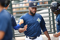 Pitcher Adonis Uceta (30) of the Columbia Fireflies is greeted after a scoreless inning in a game against the Rome Braves on Sunday, July 2, 2017, at Spirit Communications Park in Columbia, South Carolina. Columbia won, 3-2. (Tom Priddy/Four Seam Images)