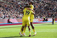 Brentford players congratulate Bryan Mbeumo after scoring their opening goal during West Ham United vs Brentford, Premier League Football at The London Stadium on 3rd October 2021