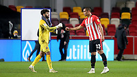 Brentford goalkeeper, David Raya and Winston Reid observe social distancing protocols at the final whistle  during Brentford vs Bristol City, Sky Bet EFL Championship Football at the Brentford Community Stadium on 3rd February 2021