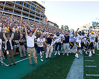 California players and staff celebrate after winning the overtime game against Colorado on Folsom Field at Boulder, Colorado on September 10th, 2011.  California defeated Colorado, 36-33 at overtime.