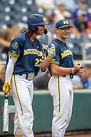 Michigan Wolverines outfielder Jordan Brewer (22) laughs with head coach Erik Bakich (23) before Game 6 of the NCAA College World Series against the Florida State Seminoles on June 17, 2019 at TD Ameritrade Park in Omaha, Nebraska. Michigan defeated Florida State 2-0. (Andrew Woolley/Four Seam Images)