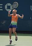 Svetlana Kuznetsova (RUS) battles against Shuai Peng (CHN) at the US Open being played at USTA Billie Jean King National Tennis Center in Flushing, NY on August 29, 2013
