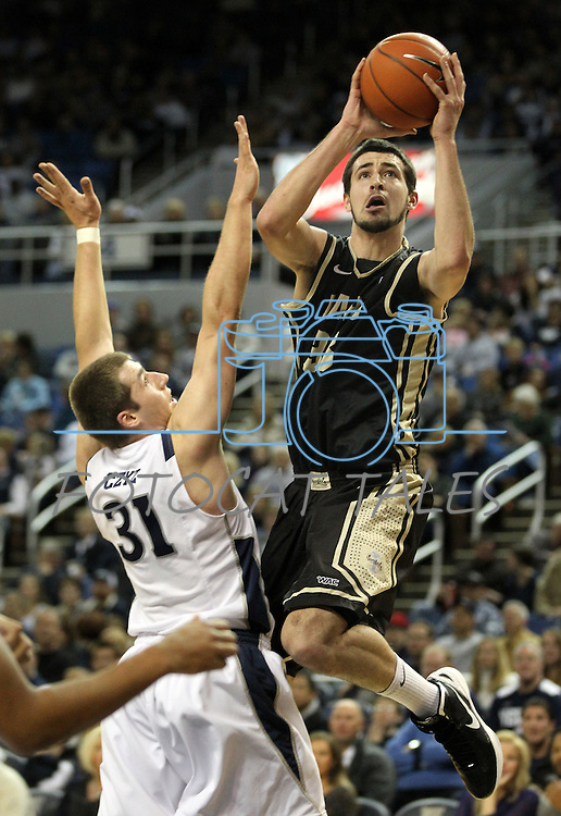Idaho's Kyle Barone shoots past Nevada's Olek Czyz during an NCAA men's basketball game in Reno, Nev., on Saturday, Feb. 4, 2012. Idaho won 72-68 breaking Nevada's 16-game winning streak..Photo by Cathleen Allison
