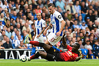 Pascal Gross of Brighton & Hove Albion (13)  and Eric Bailly of Manchester United (3) challenge for the ball  during the Premier League match between Brighton and Hove Albion and Manchester United at the American Express Community Stadium, Brighton and Hove, England on 19 August 2018. Photo by Edward Thomas / PRiME Media Images.