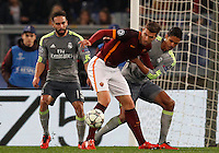 Calcio, andata degli ottavi di finale di Champions League: Roma vs Real Madrid. Roma, stadio Olimpico, 17 febbraio 2016.<br /> Roma's Edin Dzeko, right, is challenged by Real Madrid's Dani Carvajal, left, and Raphael Varane during the first leg round of 16 Champions League football match between Roma and Real Madrid, at Rome's Olympic stadium, 17 February 2016.<br /> UPDATE IMAGES PRESS/Riccardo De Luca