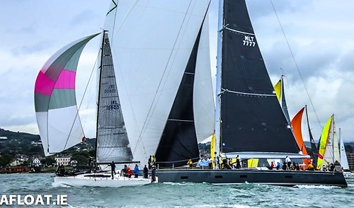Start of the 2019 Dun Laoghaire to Dingle Race, with overall winner Rockabill VI being overtaken by line honours record-setter, the SouthWind 95 Windfall (Mick Cotter). Photo: Afloat.ie/David O'Brien