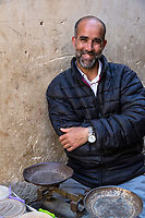 Fes, Morocco.  Vendor of Beans, Nuts, and Spices at his Stand in the Old City.