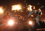 Guitarist Nathan Followill,at left, and lead singer Caleb Followill of the Kings of Leon perform at the Toyota Center Tuesday Oct. 06,2009. (Dave Rossman/For the Chronicle)