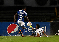 BOGOTA - COLOMBIA, 27-11-2020: Elvis Perlaza de Millonarios F. C. y Carlos Pajaro de Once Caldas disputan el balon, durante partido entre Millonarios F. C. y Once Caldas de la fecha 1 por la Liguilla BetPlay DIMAYOR 2020 jugado en el estadio Nemesio Camacho El Campin de la ciudad de Bogota. / Elvis Perlaza of Millonarios F. C. and Carlos Pajaro of Once Caldas figth for the ball, during a match between Millonarios F. C. and Once Caldas of the 1st date for the BetPlay DIMAYOR 2020 Liguilla played at the Nemesio Camacho El Campin Stadium in Bogota city. / Photo: VizzorImage / Luis Ramirez / Staff.