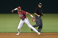 Arkansas infielder Jalen Battles (4) throws to first, Saturday, June 5, 2021 during the eighth inning in the second game of the NCAA Fayetteville Regional at Baum-Walker Stadium in Fayetteville. Check out nwaonline.com/210606Daily/ for today's photo gallery. <br /> (NWA Democrat-Gazette/Charlie Kaijo)