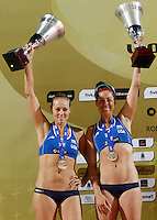 Jennifer Kessy, left, and <br /> April Ross, of the United States, hold the second places' trophies at the end of the women's final match between Brazil and United States at the Beach Volleyball World Tour Grand Slam, Foro Italico, Rome, 23 June 2013. Brazil defeated United States 2-1.<br /> UPDATE IMAGES PRESS/Isabella Bonotto