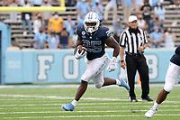CHAPEL HILL, NC - OCTOBER 10: Javonte Williams #25 of North Carolina runs for 25 yards during a game between Virginia Tech and North Carolina at Kenan Memorial Stadium on October 10, 2020 in Chapel Hill, North Carolina.