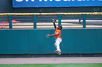 Norfolk Tides right fielder Xavier Avery (15) catches a fly ball during a game against the Rochester Red Wings on July 17, 2016 at Frontier Field in Rochester, New York.  Rochester defeated Norfolk 3-2.  (Mike Janes/Four Seam Images)