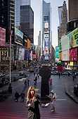 New York, New York<br /> March 18, 2020<br /> 10:55 AM<br /> <br /> Manhattan under coronavirus pandemic. <br /> <br /> Times Square void of most tourists, inhabited by the homeless and the media due to fear of spreading the virus.