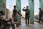 22/07/14  Iraq -- Daquq, Iraq -- Peshmerga makes the military salute with a brum instead of the gun, at the base in Daquq.