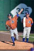 Durham Bulls starting pitcher Mike Montgomery (22) warms up in the bullpen as pitching coach Neil Allen (17) looks on before a game against the Buffalo Bisons on July 10, 2014 at Coca-Cola Field in Buffalo, New  York.  Durham defeated Buffalo 3-2.  (Mike Janes/Four Seam Images)