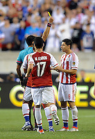 Philadelphia, PA - June 11, 2016: Paraguay midfielder Rodrigo Rojas (8) and REF. Julio Bascuñán during a Copa America Centenario Group A match between United States (USA) and Paraguay (PAR) at Lincoln Financial Field.
