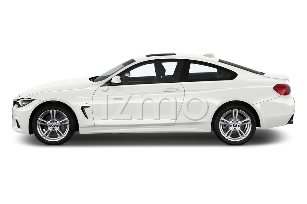 Car driver side profile view of a 2019 BMW 4 series M Sport 2 Door Coupe