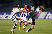 Pachuca CF midfielder Christian Gimenez (19) and New England Revolution midfielder Pat Phelan (28) play a ball. The New England Revolution defeated Pachuca CF 1-0 during a Group B match of the 2008 North American SuperLiga at Gillette Stadium in Foxborough, Massachusetts, on July 16, 2008.