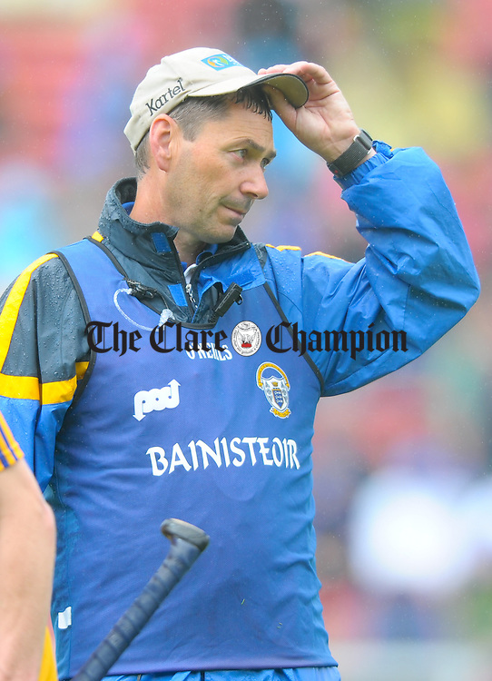 A dissapointed Clare manager Eamon Fennessy  following the Munster minor hurling final against Tipperary at Pairc Ui Chaoimh. Photograph by John Kelly.
