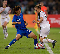 USWNT forward (8) Amy Rodriguez  fights for the ball with Japanese midfielder (15) Mizuho Sakaguchi while playing at Worker's Stadium.  The USWNT defeated Japan, 4-2, during the semi-finals of the Beijing 2008 Olympics in Beijing, China.
