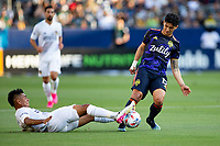 CARSON, CA - JUNE 19: Efrain Alvarez #26 of the Los Angeles Galaxy attempts to tackle Fredy Montero #12 of the Seattle Sounders FC during a game between Seattle Sounders FC and Los Angeles Galaxy at Dignity Health Sports Park on June 19, 2021 in Carson, California.