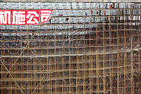Workers operate on steel scaffoldings at the main 2010 World Expo site currently under construction in Shanghai, China..13 Jul 2009