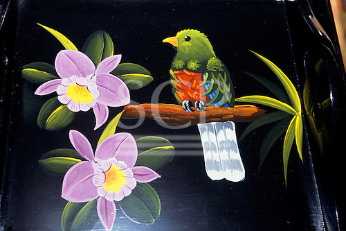 Sarchi, Costa Rica. Tropical bird and flowers painted on a tray at the workshop of artist Carlos Chaverri.