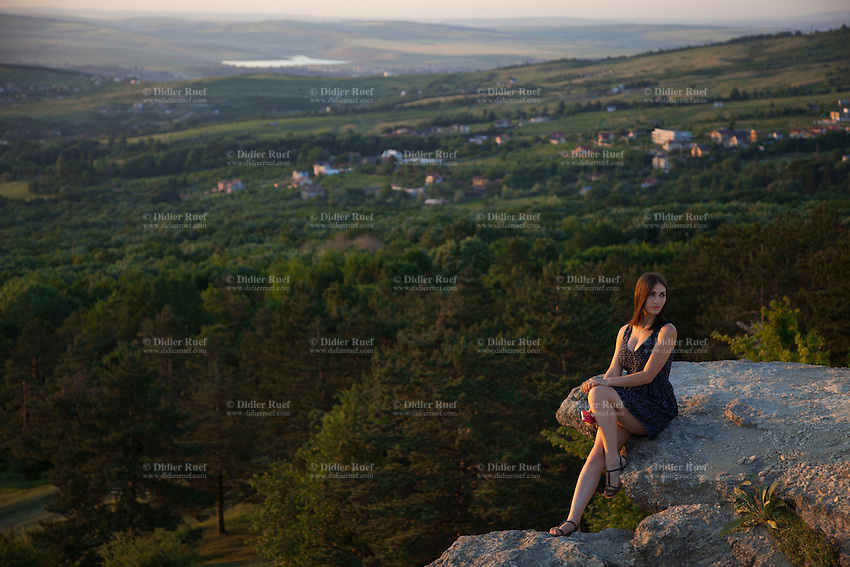 Romania. Iași County. Iasi. Bucium hill. A stylish and smiling young woman is posing at sunset while her girlfriend is taking a picture of her. She is holding a smartphone in her right hand. Iași (also referred to as Iasi, Jassy or Iassy) is the largest city in eastern Romania and the seat of Iași County. Located in the Moldavia region, Iași has traditionally been one of the leading centres of Romanian social life. The city was the capital of the Principality of Moldavia from 1564 to 1859, then of the United Principalities from 1859 to 1862, and the capital of Romania from 1916 to 1918. 13.06.15 © 2015 Didier Ruef