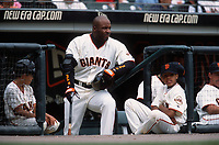 SAN FRANCISCO, CA:  Barry Bonds of the San Francisco Giants stands near his son Nikolai Bonds in the dugout during a game at Pacific Bell Park in San Francisco, California in 2001. (Photo by Brad Mangin)
