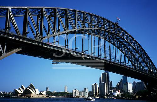 Sydney, NSW, Australia. World famous Sydney Harbour Bridge with Sydney Opera House and skyline visible underneath.