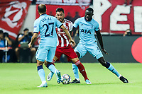 Harry Winks of Tottenham Hotspur in action with Miguel Angel Guerrero of Olympiacos Fc, during the UEFA Champions League match between Olympiacos Fc and Tottenham Hotspur, in Karaiskaki Stadium in Piraeus, Greece. Wednesday 18 September 2019