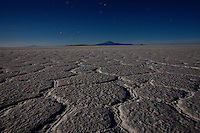 """Uyuni Salt Flats, Bolivia<br /> September 11, 2011<br /> A night voew with moon light of the texture of the salt in the Uyuni Salt Flats, the largest salt desert in the world and one of the main attractions for the Dakar 2014 next January.  ©PATRICIO CROOKER/ARCHIVO LATINO For  the first time in its history,  in January 2014 the Dakar Rally will  be cross part of Bolivia, one of the wildest South American nations.  """"The organizers of the Dakar, attracted by the discovery of new spaces, were conquered by Bolivian landscapes that can be classified among the most striking of the continent,"""" says the official site of the international race.<br /> The most impressive is the section that runs through the Salar of Uyuni,  considered the world's largest salt flat and a place of surreal beauty, almost otherworldly.<br /> The competition is scheduled for  in January 2014. Our photographer and  friend Patricio Crooker  show us  the unique beauty of the places the rally will hit."""