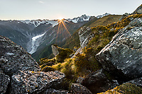 Sun rising over Southern Alps, above Fox Glacier with Mt. Tasman and Mt. Cook on right, Westland Tai Poutini National Park, West Coast, South Westland, UNESCO World Heritage Area, New Zealand, NZ