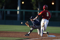Connor Spencer #33 of the UC Irvine Anteaters takes a throw to first base during a game against the Southern California Trojans at Dedeaux Field on April 29, 2014 in Los Angeles, California. Stanford defeated Southern California, 6-2. (Larry Goren/Four Seam Images)