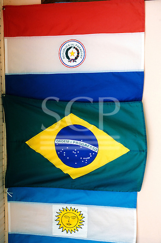 Iguassu, Brazil. The flags of Argentina, Brazil and Paraguay, the three countries which meet there.