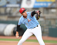 Hickory Crawdads starting pitcher Hans Crouse (10) throws to a batter during a game with the Asheville Tourists at L.P. Frans Stadium on May 8, 2019 in Hickory, North Carolina.The Tourists defeated the Crawdads 7-6. (Tracy Proffitt/Four Seam Images)
