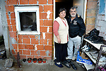 Fatmir Kruezi and his wife Sabahata in the doorway of their home in the Zemun Polje neighborhood of Belgrade, Serbia. Refugees from Serbia in 1980, the Roma couple still face obstacles to full participation in Serbian society. They can't afford regular school fees, so their son attends the Branko Pesic School, an educational center for Roma children and families which is supported by Church World Service. The family is Muslim in a predominantly Christian Orthodox country.