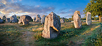 View of Carnac neolthic standing stones monaliths, Alignements du Kermario, a pre-Celtic site of standing stomes used from 4500 to 2000 BC,<br /> <br /> Carnac is famous as the site of more than 10,000 Neolithic standing stones, also known as menhirs. The stones were hewn from local rock and erected by the pre-Celtic people of Brittany. The Carnac stones were erected during the Neolithic period which lasted from around 4500 BC until 2000 BC. One interpretation of the site is that successive generations visited the site to erect a stone in honour of their ancestors.