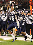 Nevada Wolf Pack wide receiver Rishard Matthews makes a reception during the NCAA college football game Saturday night, Nov. 26, 2010, in Reno, Nev. (AP Photo/Cathleen Allison)