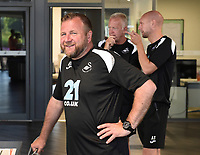 (L-R) Billy Reid, assistant manager, Alan Curtis, assistant coach and Adrian Tucker during the Swansea City Players Return to Pre-Season Training at The Fairwood Training Ground, Wales, UK. Monday 02 July 2018