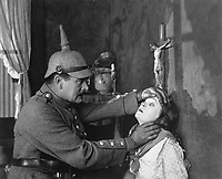 Mae Marsh, as a Belgian girl, and A.C. Gibbons as a German soldier, in Goldwyn's all-star Liberty Loan picture, Stake Uncle Sam to Play Your Hand.  1918. (Bureau of Public Debt)<br />Exact Date Shot Unknown<br />NARA FILE #:  053-LL-8-1<br />WAR & CONFLICT BOOK #:  525
