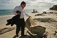 New Zealand Foreign Minister Murray McCully, representing the New Zealand government, returns to a holiday resort at which he himself had stayed three months before. All that's left is its sign. More than 170 people died when a tsunami triggered by an 8.3 magnitude earthquake hit Samoa and neighbouring Pacific islands on 29/09/2009. Samoa (formerly known as Western Samoa)..
