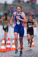 26 AUG 2012 - STOCKHOLM, SWE - Non Stanford  (GBR) of Great Britain (centre) leads Rebecca Robisch (GER) (right) of Germany  during their run leg at the 2012 ITU Mixed Relay Triathlon World Championships in Gamla Stan, Stockholm, Sweden .(PHOTO (C) 2012 NIGEL FARROW)