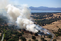 aerial photograph of a spreading grassfire near Lakeport, CA shortly after ignition, Clear Lake, Lake County, California.