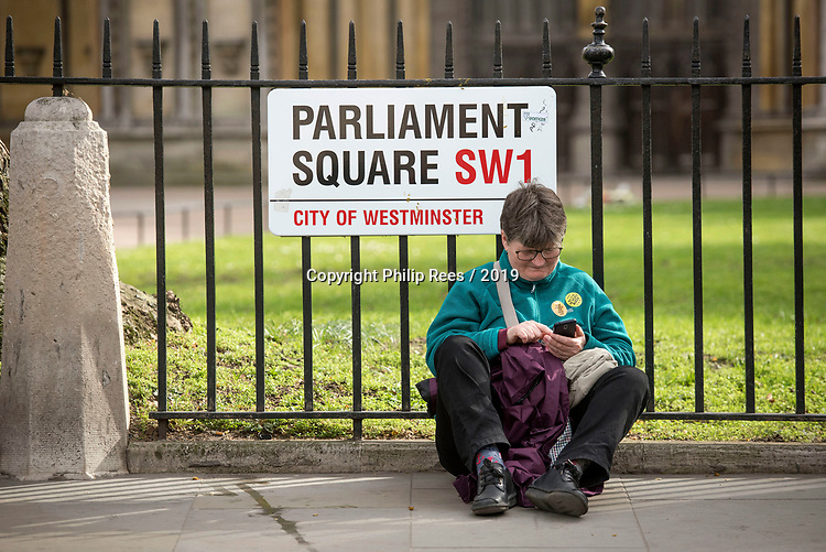 """A protester sits down in Parliament Square during the """"Put it to the People"""" rally which made it's way through central London today. Demonstrators from across the country gathered to call for a second referendum on Brexit and to march through the UK capital finishing with speeches in Parliament Square opposite the Houses of Parliament in Westminster."""